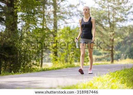 Woman walking outdoor in the forest as workout - stock photo