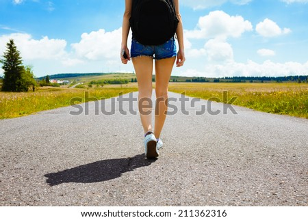 Woman walking towards unknown places. - stock photo