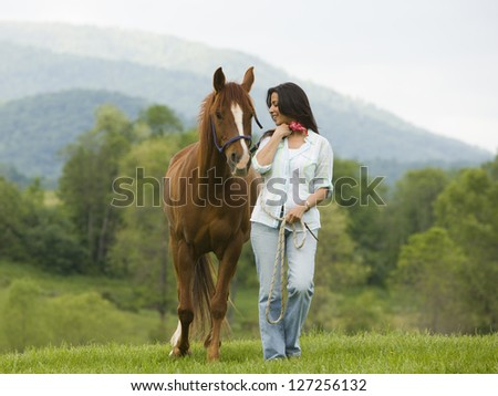 Woman walking with a horse