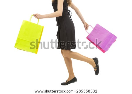 Woman walking with shopping bags in her hands
