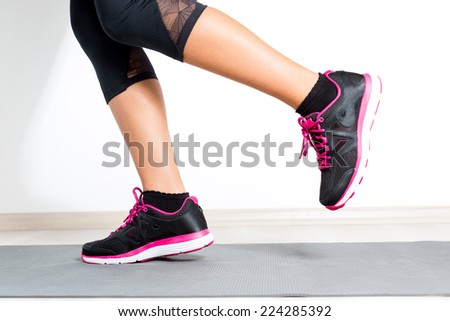 Woman warming up for exercise - stock photo