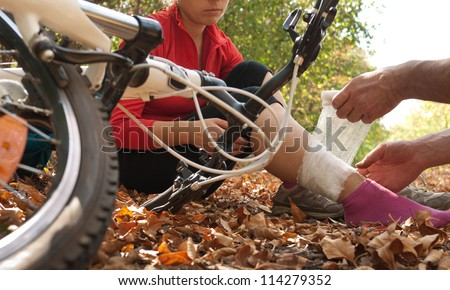 woman was falled off bicyle - stock photo