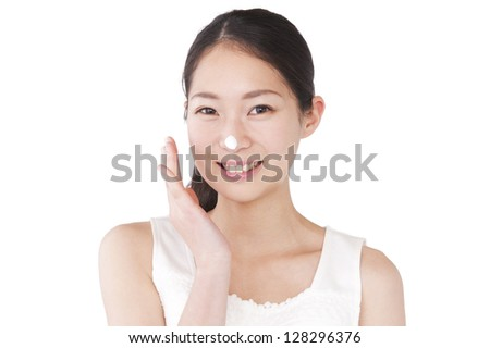 Woman wash face with cleanser - stock photo