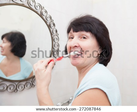 woman washes in   bath in   morning. - stock photo