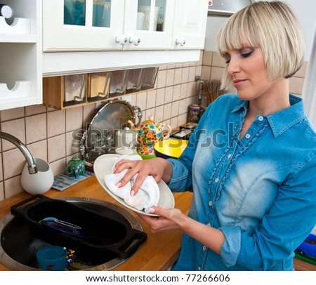 woman washing dishes in her kitchen