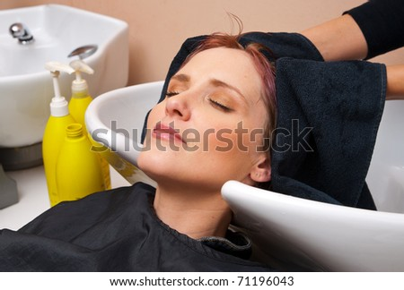 woman washing hair in salon - stock photo