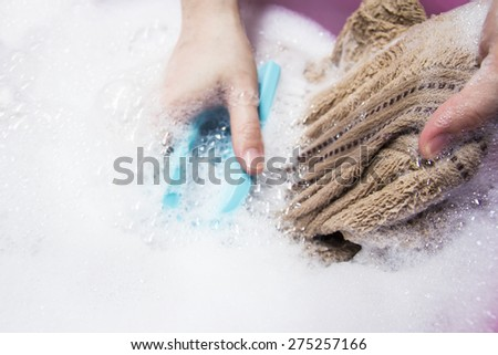 Woman washing towel