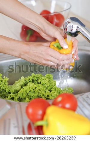woman washing vegetable