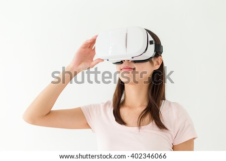 Woman watch though VR device - stock photo