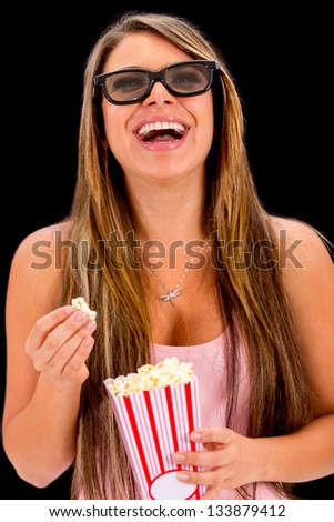 Woman watching a 3D movie with glasses and eating popcorn