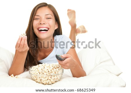 Woman watching funny movie laughing. Isolated on white background. - stock photo