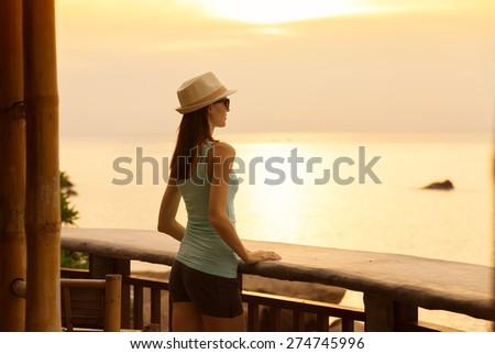 Woman watching the sunrise.  - stock photo