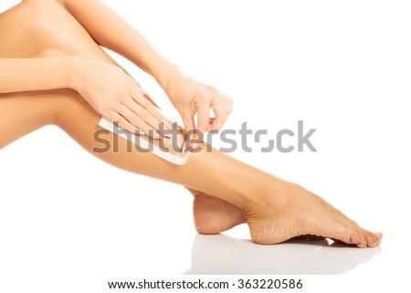 Woman waxing her leg - stock photo