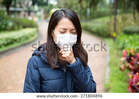 Woman wear facemask outdoor - stock photo