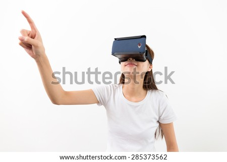 Woman wear with with VR device and finger touch in air - stock photo