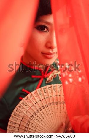 Woman wearing a cheongsam,Chinese classical costumes - stock photo