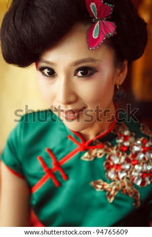 https://thumb9.shutterstock.com/display_pic_with_logo/570949/570949,1328813029,2/stock-photo-woman-wearing-a-cheongsam-chinese-classical-costumes-94765609.jpg