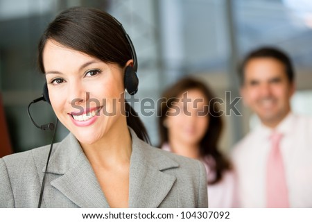 Woman wearing a headset working at customer support - stock photo