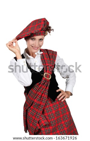 Woman wearing a kilt - stock photo