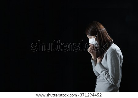 Woman wearing a mask, cold