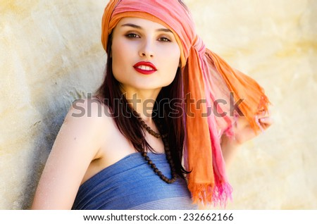 Woman wearing a turban in the desert - stock photo