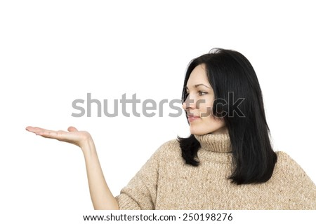 woman wearing beige sweater holding arm palm up isolated over white  - stock photo