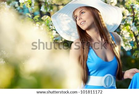 Woman wearing blue dress in amazing fruits garden - stock photo