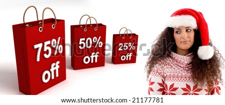 woman wearing christmas hat posing with three dimensional shopping bag - stock photo