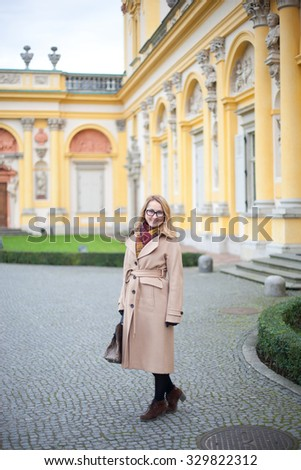 Woman wearing elegant coat. Autumn, cloudy day - stock photo
