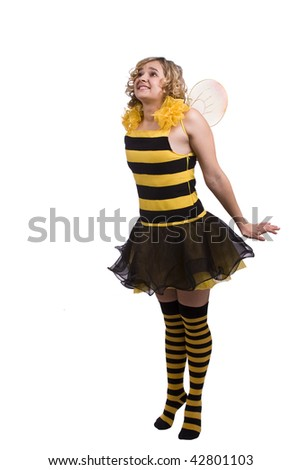 Woman wearing fancy dress on Halloween looking up. A young woman dressed up as bumblebee express astonishment. Cute girl in bee costume on white. - stock photo