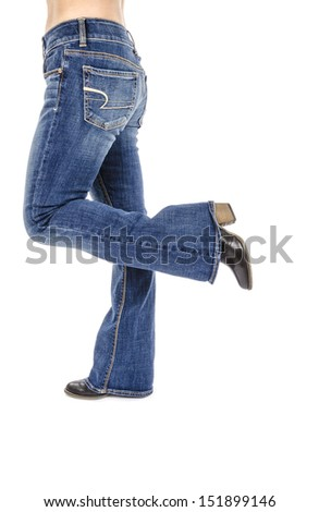 Woman Wearing Flared Blue Jeans and Black Ankle Boots Isolated on White - stock photo