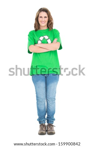 Woman wearing green tshirt with recycling symbol crossing arms on white background - stock photo