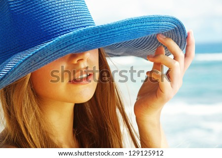 woman wearing hat - stock photo