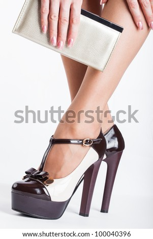 Woman wearing high heels on white background - stock photo