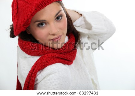 Woman wearing matching hat and scarf