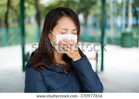 Woman wearing protective face mask - stock photo