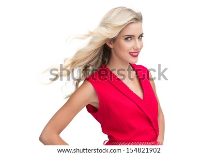 Woman wearing red dress smiling at camera against white background