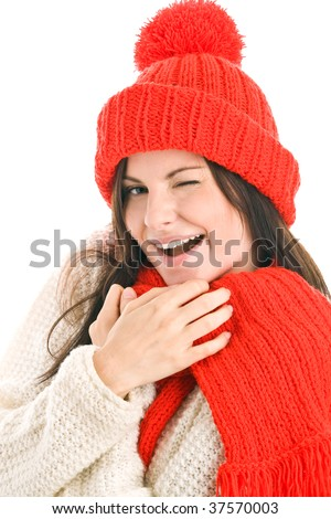 Woman wearing red scarf and cap winking isolated on white background
