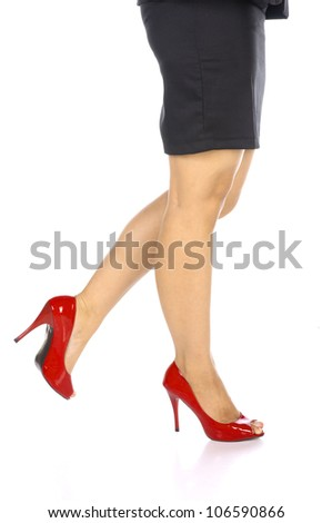 Woman wearing red shoes isolated over white background - stock photo
