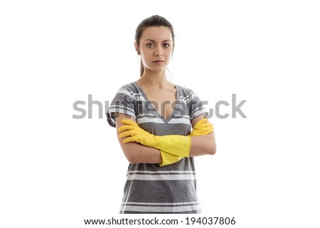 woman wearing rubber washing up gloves not looking a bit unhappy - stock photo