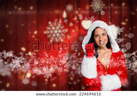 Woman wearing sexy christmas clothes against blurred christmas background - stock photo
