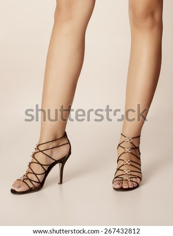 Woman wearing strappy sandals - stock photo