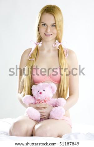 woman wearing underwear with teddy bear - stock photo