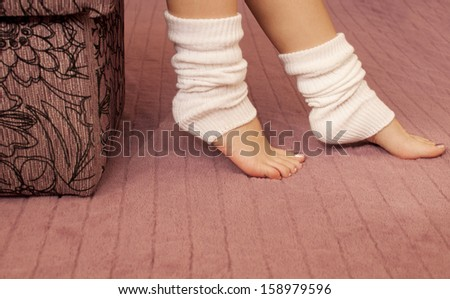 Woman wearing white leg warmers - stock photo
