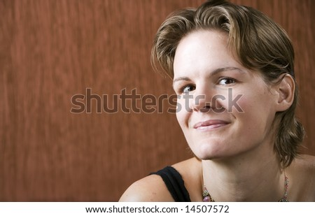 Woman wering a necklace looking at the camera - stock photo