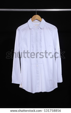 Woman white shirt clothes on a hanger isolated