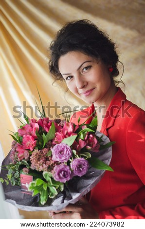 Woman who has just received a bunch of flowers