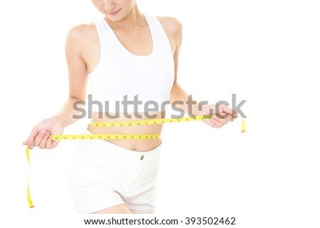 Woman who is measuring her waist - stock photo