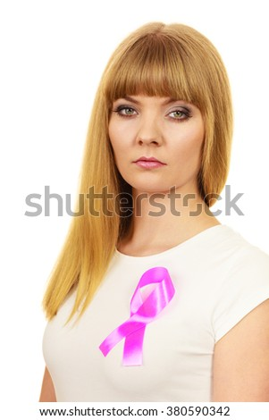 Woman wih pink cancer ribbon on chest.  Sad, worried and concerned facial expression. Health care, medicine and breast cancer awareness concept.  - stock photo