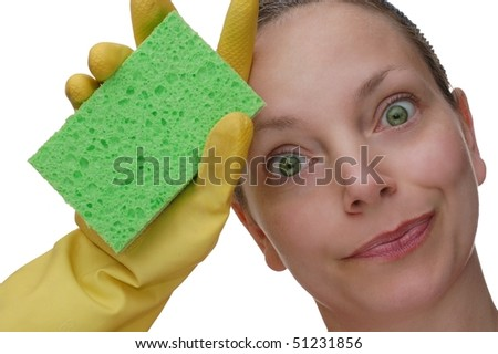 Woman Wiping Brow Expressively After Cleaning with a Sponge - stock photo
